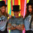 """Christian Audigier entouré des belles Nathalie Sorensen et Angie Torres lors de la séance photo pour sa marque """"Lord and Lady Baltimore"""" à Los Angeles le 10 novembre 2012"""