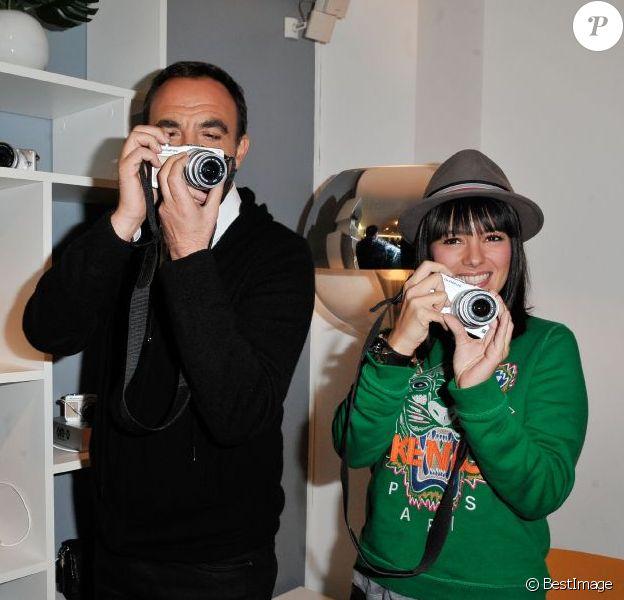 Nikos Aliagas et Alizée à la soirée de lancement de l'appareil photo Olympus 'Pen Lite' à la boutique Ephemere Olympus à Paris le 6 Decembre 2012.