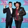 Simon Cowell et Tate Stevens le soir de la grande finale de X Factor saison 2, à Los Angeles le 20 décembre 2012.
