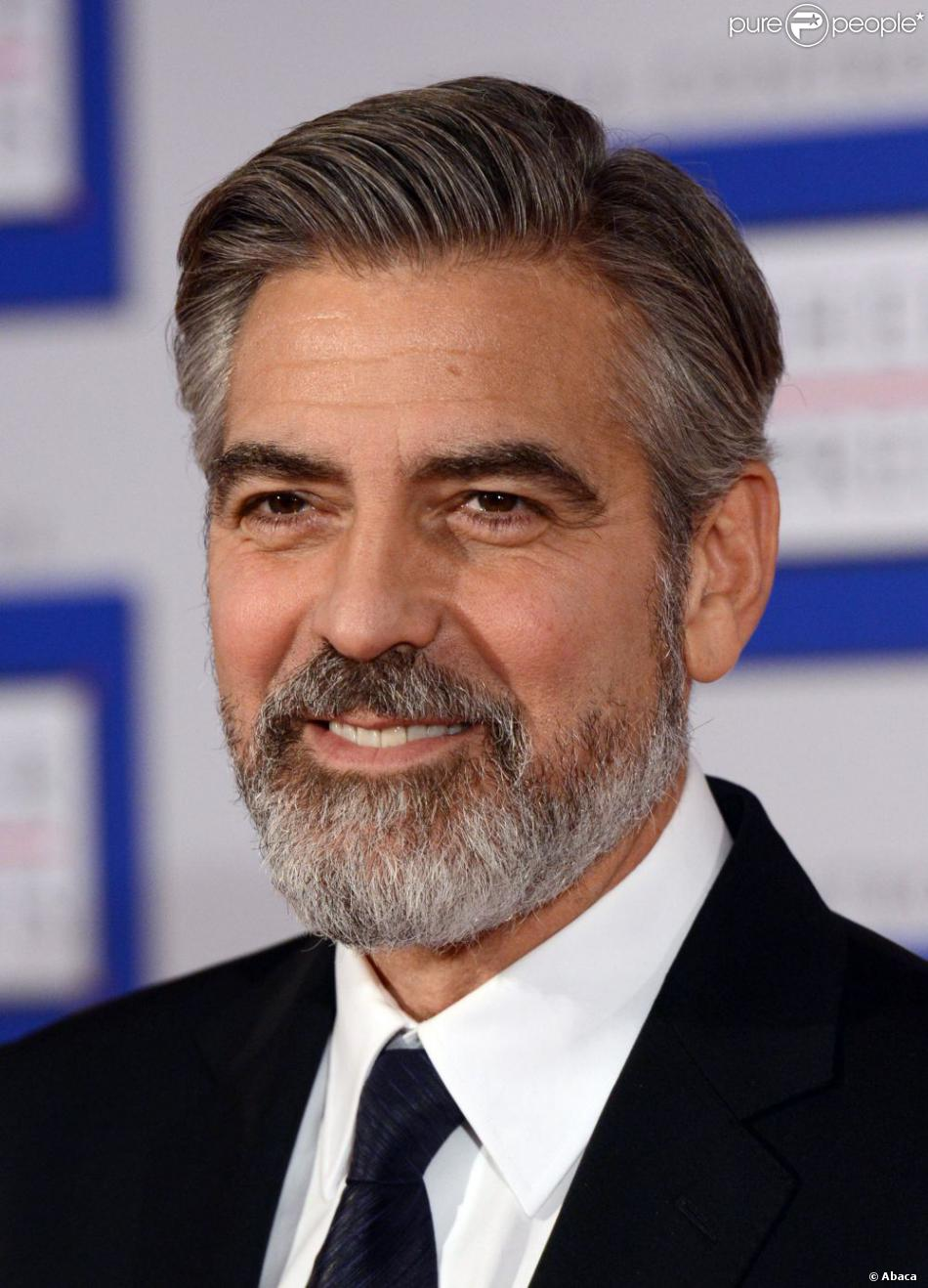 1086541-us-actor-george-clooney-poses-after-950x0-1