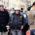 Gérard Depardieu, son casque sur la tete, dans les rues de Paris le 11 avril 2013.