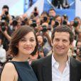 Marion Cotillard et Guillaume Canet au photocall du film Blood Ties au 66e Festival du film de Cannes, le 20 mai 2013.
