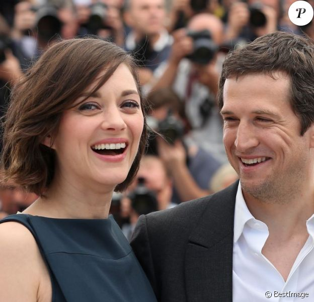 Marion Cotillard et Guillaume Canet radieux au photocall du film Blood Ties au 66e Festival du film de Cannes, le 20 mai 2013.