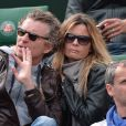 Denis Brogniart et sa femme Hortense assistent au match de Gaël Monfils au 2e Tour des Internationaux de France de tennis de Roland Garros le 29 mai 2013