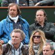 Philippe Candeloro assiste au match de Gaël Monfils au 2e Tour des Internationaux de France de tennis de Roland Garros le 29 mai 2013