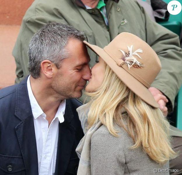 Yann Delaigue et Astrid Bard, amoureux lors du quatrième jour des Internationaux de France à Roland-Garros le 29 mai 2013
