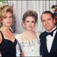 Paul-Loup Sulitzer avec sa fille et sa femme Delphine Jacobson. Le 30 juin 1993.