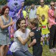 """La princesse Mary de Danemark lors de la course de relais pour enfants """" Fri for Mobberi """" le 15 juin 2013 au grand parc de Copenhague, une initiative de la Fondation Princesse Mary et l'association Red Barnet dans le cadre de la lutte contre les intimidations et l'exclusion en milieu scolaire."""