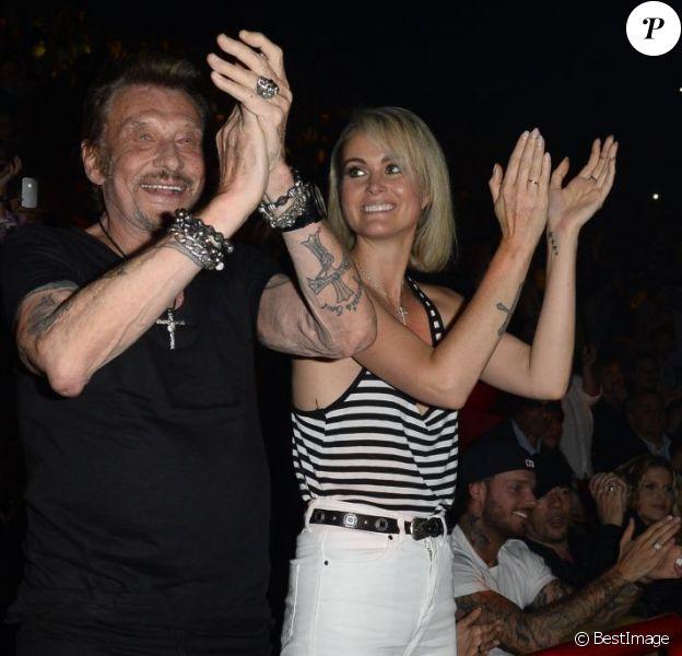 Johnny et Laeticia Hallyday assistent au concert de Patrick Bruel à Bercy. Paris, le 22 juin 2013.