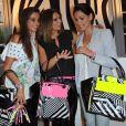 Malika Ménard, Laury Thilleman et Laetitia Bleger lors de la présentation du sac de Laury Thilleman pour la marque La Halle à Paris, le 27 juin 2013