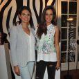 Malika Ménard et Laetitia Bleger lors de la présentation du sac de Laury Thilleman pour la marque La Halle à Paris, le 27 juin 2013