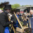 Le prince Charles et Camilla Parker Bowles le 11 juillet 2013 au premier jour du Coronation Festival organisé à Buckingham Palace, à l'occasion des 60 ans du couronnement d'Elizabeth II, par la Royal Warrants Holders Association.