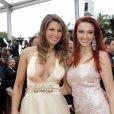 Laury Thilleman (Miss France 2011) et Delphine Wespiser (Miss France 2012) à la montée des marches du film Jeune et Jolie, pour l'ouverture du 66e Festival du film de Cannes, le 16 mai 2013.