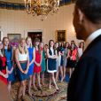 Barack Obama a rencontré des joueuses de basket à la Maison Blanche à Washington en juin 2013. Il s'agissait des championnes de la division III, de l'équipe des Tigers de la DePauw University.