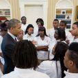 Barack Obama discute avec des étudiants de la William R. Harper High School à la Maison Blanche. Juin 2013.