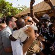 Barack Obama est allé à la rencontre de la population lors de son voyage au Sénégal. Il était ici sur l'île de  Gorée. Juin 2013.