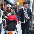 Drew Barrymore et son mari Will Kopelman lors d'une sortie dans New York avec leur fille Olive le 20 Janvier 2013