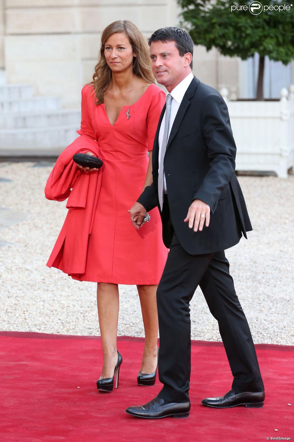 Manuel Valls et son épouse Anne Gravoinlors d'un dîner d'Etat à l'Elysée le 3 septembre 2013.