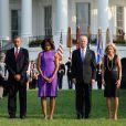 Barack Obama, Michelle Obama, et Jill et Joe Bidenrendent hommage aux victimes des attentats du World Trade Center à la Maison Blanche le 11 septembre 2013.