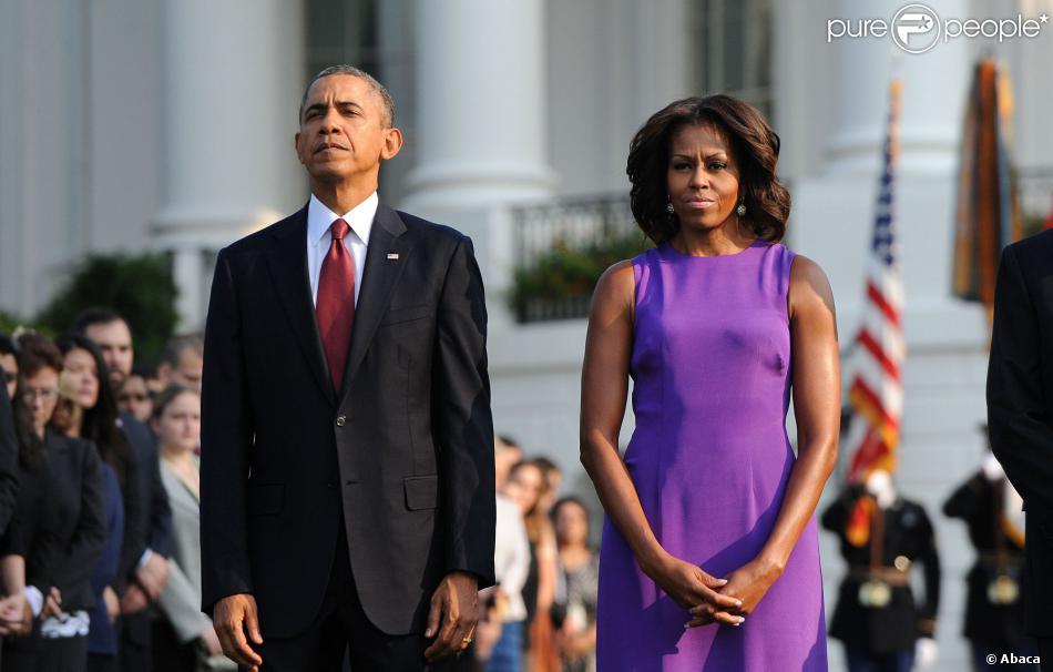 Barack Obama et Michelle Obama rendent hommage aux victimes des attentats du World Trade Center à la Maison Blanche le 11 septembre 2013.