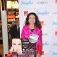 Andie MacDowell lors d'un événement de charité organisé dans une parfumerie de Berlin avec la marque L'Oreal le 12 septembre 2013