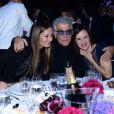 Eva et Roberto Cavalli au côté de Lewis Juliette lors du gala de l'amfAR à Milan, le 21 septembre 2013.