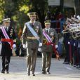 Le prince Felipe et la princesse Letizia d'Espagne lors de la parade militaire pour la fête nationale d'Espagne à Madrid, le 12 octobre 2013.