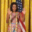 La jolie First Lady américaine Michelle Obama a eu droit à un cours de danse façon Bollywood lors d'une fête pour Diwali, à la Maison-Blanche, le 5 novembre 2013.