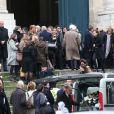 Exclusif - Frédéric Martin, Céline Boisson et sa fille Juliette Martin lors des obsèques du grand ami de Jacques Martin, Paul Ceuzin, en l'église Saint-Roch à Paris, le 19 novembre 2013