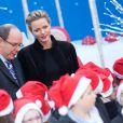 Le prince Albert II de Monaco et la princesse Charlene ont fêté le Noël des enfants au palais princier à Monaco, le 18 décembre 2013.