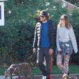 Leighton Meester et son fiancé Adam Brody se promènent avec leurs dans les rues de Los Angeles, le 22 décembre 2013.