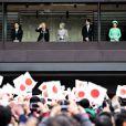 La princesse héritière Masako et le prince héritier Naruhito, l'empereur Akihito et sa femme l'impératrice Michiko, le prince Akishino, son épouse, la princesse Kiko, et sa fille, la princesse Mako - La famille impériale du Japon saluent depuis un balcon du palais la foule venue nombreuse pour célébrer le 80eanniversaire de l'empereur, à Tokyo le 23 décembre 2013.