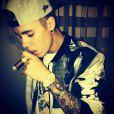 Justin Bieber a publié une photo de lui en train de fumer un cigare sur son profil Instagram, le 22 janvier 2014.