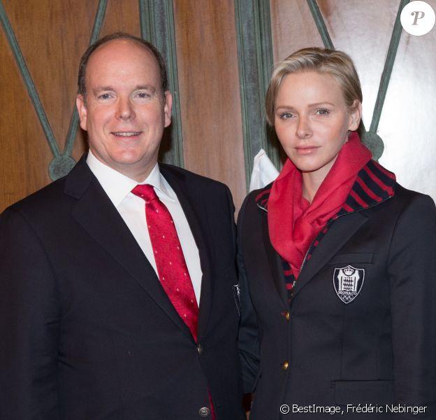 Le prince Albert II de Monaco et la princesse Charlene lors de la présentation des six athlètes de la délégation monégasque pour les JO d'hiver de Sotchi, le 29 janvier 2014.