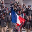 La délégation française, menée par le skieur Jason Lamy-Chappuis, pénètre dans le stade olympique de Fisht - Cérémonie d'ouverture des Jeux olympiques de Stochi, le 7 février 2014.