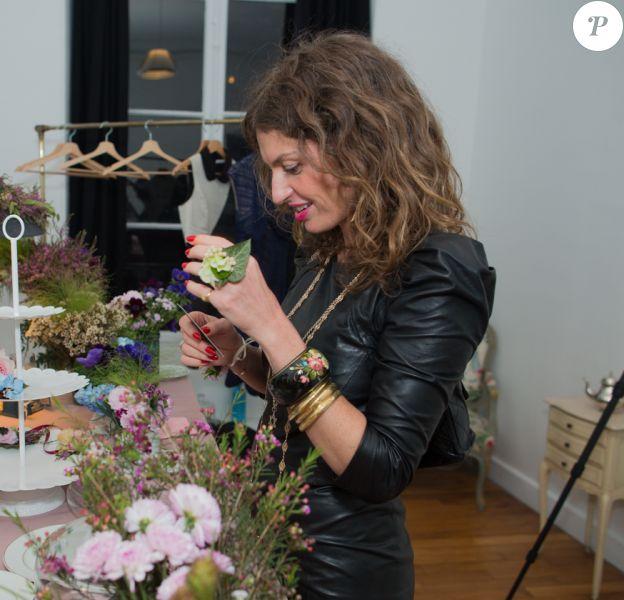 La chanteuse Aurélie Saada lors de la soirée de lancement de la collection Vogue Eyewear x Charlotte Ronson. Paris, le 25 février 2014.