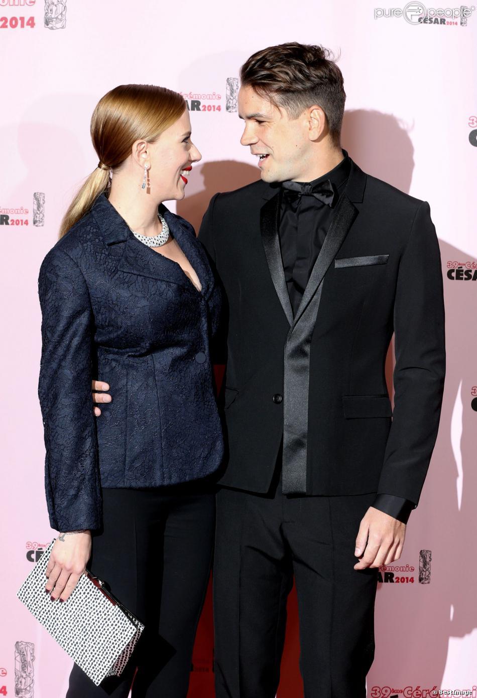 Scarlett Johansson (César d'honneur) et son fiancé Romain Dauriac lors de la 39e cérémonie des César au théâtre du Châtelet à Paris, le 28 Février 2014.