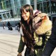Rihanna, souriante à l'aéroport d'Heathrow. Londres, le 24 mars 2014.