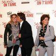 Bernard Tapie avec sa femme Dominique et sa fille Sophie à l'avant-première du film Salaud on t'aime à l'UGC Normandie sur les Champs-Elysées, Paris, le 31 mars 2014.