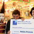 """Christophe Beaugrand et Dominique Bayle (cofondatrice de l'association Petits Princes) - Soirée d'ouverture de la """"Foire du Trone"""" au profit de l'association Petits Princes à Paris le 4 avril 2014."""