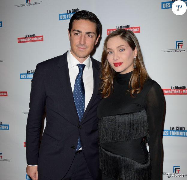 Isabella Orsini avec son mari le prince Edouard de Ligne de la Tremoïlle au 1er Gala Sport et Philanthropie, à Roland-Garros le 28 mai 2014. Le couple a eu quelques jours plus tôt son premier enfant, une petite princesse.