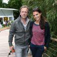 Stéphane Freiss et sa compagne Ursula lors des Internationaux de France à Roland-Garros à Paris, le 29 mai 2014