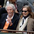 Jean Rochefort et sa femme Françoise Vidal lors des Internationaux de France à Roland-Garros à Paris, le 29 mai 2014