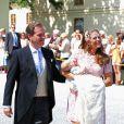 La princesse Madeleine de Suède et son mari Christopher O'Neill ont posé avec leur fille la princesse Leonore à l'extérieur de la chapelle royale lors de son baptême à Stockholm le 8 juin 2014.