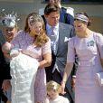 La princesse Victoria de Suède, marraine, et sa fille la princesse Estelle étaient radieuses pour le baptême de la princesse Leonore de Suède, fille de la princesse Madeleine et de Christopher O'Neill, le 8 juin 2014 en la chapelle du palais Drottningholm à Stockholm.