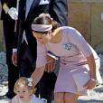 La princesse Victoria et sa fille la princesse Estelle au baptême de la princesse Leonore de Suède, fille de la princesse Madeleine et de Christopher O'Neill, le 8 juin 2014 en la chapelle du palais Drottningholm à Stockholm.