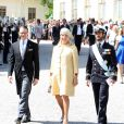 Le prince Daniel, Eva O'Neill et le prince Carl Philip au baptême de la princesse Leonore de Suède, fille de la princesse Madeleine et de Christopher O'Neill, le 8 juin 2014 en la chapelle du palais Drottningholm à Stockholm.