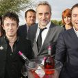 Eric Serra, Antoine Dulery et Bernard Montiel prennent la pose pour les vins Bordeaux Rosés durant La Fête Du Vin 2014 à Bordeaux, le 28 juin 2014.