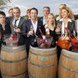 Bernard Montiel, Sofia Essaidi, Nathalie Dessay, Eric Serra, Corinne Touzet, Fauve Hautot, Joel Dupuch, Antoine Dulery et Laurent Naouri prennent la pose pour les vins Bordeaux Rosés durant La Fête Du Vin 2014 à Bordeaux, le 28 juin 2014.