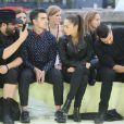 Joe Jonas, Cara Santana et Jesse Metcalfe assistent au défilé homme Kenzo printemps-été 2015, au Pont Alexandre III. Paris, le 28 juin 2014.